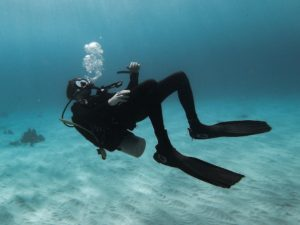 a scuba diver underwater blowing bubbles