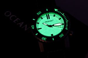 close up luminous dive watch face