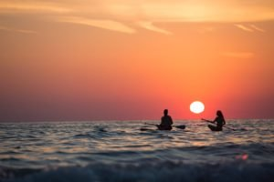 people-on-paddleboards-in-the-sunset