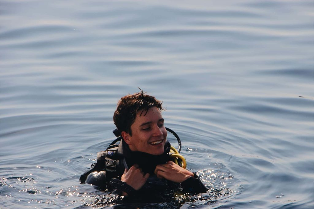 diver smiling on surface