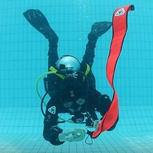 Diver inflating SMB underwater